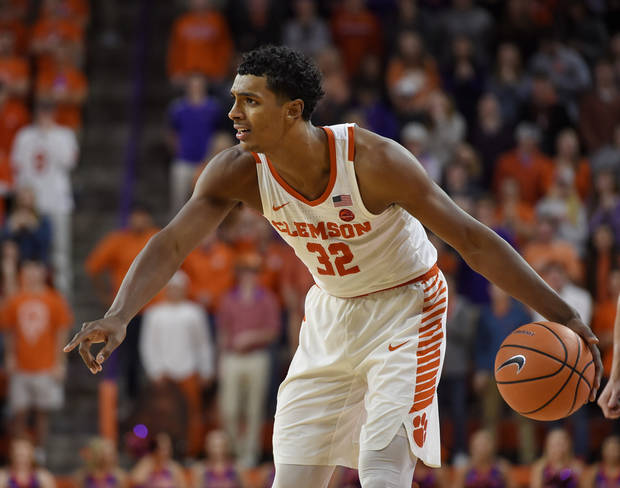 Clemson's Donte Grantham looks to pass during the second half of an NCAA college basketball game against Miami Saturday, Jan. 13, 2018, in Clemson, S.C. Clemson won 72-63. (AP Photo/Richard Shiro)