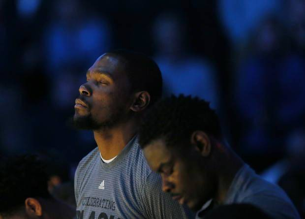 Oklahoma City's Kevin Durant (35), left, and Anthony Morrow (2) observe a moment of silence in memory of Ingrid Williams, the wife of Oklahoma City Thunder assistant coach Monty Williams, before an NBA basketball game between the New Orleans Pelicans and the Oklahoma City Thunder at Chesapeake Energy Arena in Oklahoma City, Thursday, Feb. 11, 2016. Ingrid Williams died Wednesday evening after being injured in a car crash Tuesday night. Photo by Nate Billings, The Oklahoman