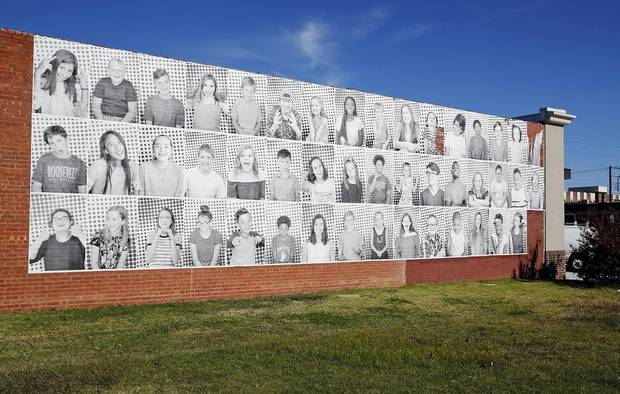Portraits of Oklahoma schoolchildren are displayed at one of the sites of Faces of the 47th, a large-scale art installation to raise awareness of Oklahoma's low ranking for education funding, at 309 W Main Street in Norman, Okla., Monday, Oct. 29, 2018. [Nate Billings, The Oklahoman Archives]