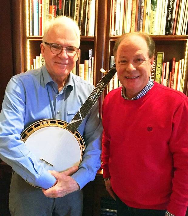 Steve Martin, left, and American Banjo Museum Executive Director Johnny Baier pose for a photo with the one-of-a-kind banjo Martin recently donated to the Oklahoma City museum. [Photo provided]