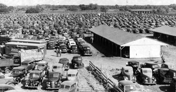View of the dirt parking area used by visitors to the State Fair of Oklahoma in September of 1941. Fair was still at its old Eastern/NE 10 location at this time. Staff photo dated 9/27/1941.