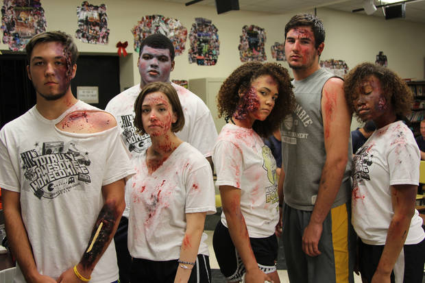 This is not a scene from The Walking Dead. This group of Midwest City High School students acted as crash victims in a staged DUI crash. Photo: Michaela Marx Wheatley