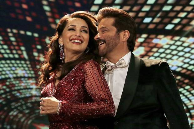 "Madhuri Dixit, left, and Anil Kapoor co-star in the Bollywood film ""Total Dhamaal."" [Fox Star Studios photo]"