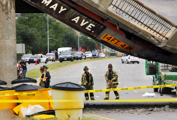 A section of the May Ave. bridge above the Northwest Expressway collapsed when it was hit by a truck Thursday afternoon, in Oklahoma City. No injuries were reported. Photo by Jim Beckel, The Oklahoman
