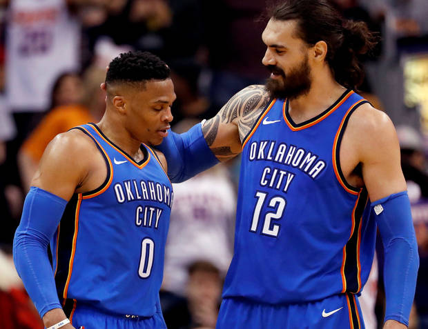Oklahoma City Thunder center Steven Adams (12) embraces guard Russell  Westbrook (0) 7d66113b8
