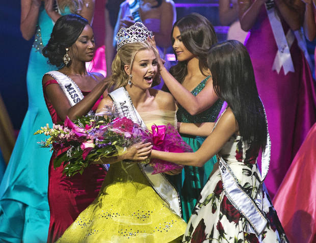 In this July 30, 2016 photo, Miss Texas Karlie Hay is crowned and given flowers as the new Miss Teen USA 2016 during the pageant in Las Vegas. Racist language in old tweets from the freshly crowned Miss Teen USA is just the latest controversy for the Miss Universe Organization, which suffered a round of turmoil last year over then-owner Donald Trump's inflammatory comments against Mexicans. (L.E. Baskow/Las Vegas Sun via AP)
