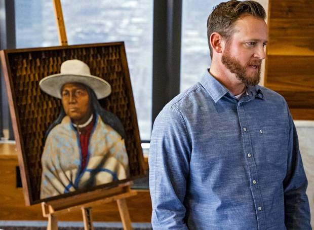 Citizen Potawatomi artist Stuart Sampson speaks about his artwork, which was displayed during a Red Earth press conference at the Petroleum Club in Oklahoma City, Okla. on Monday, Feb. 17, 2020. The news conference announced a new location for the annual Red Earth Festival, a new fall event to mark Oklahoma City's Indigenous Peoples Day and the launch of arts events around the state. [Chris Landsberger/The Oklahoman]