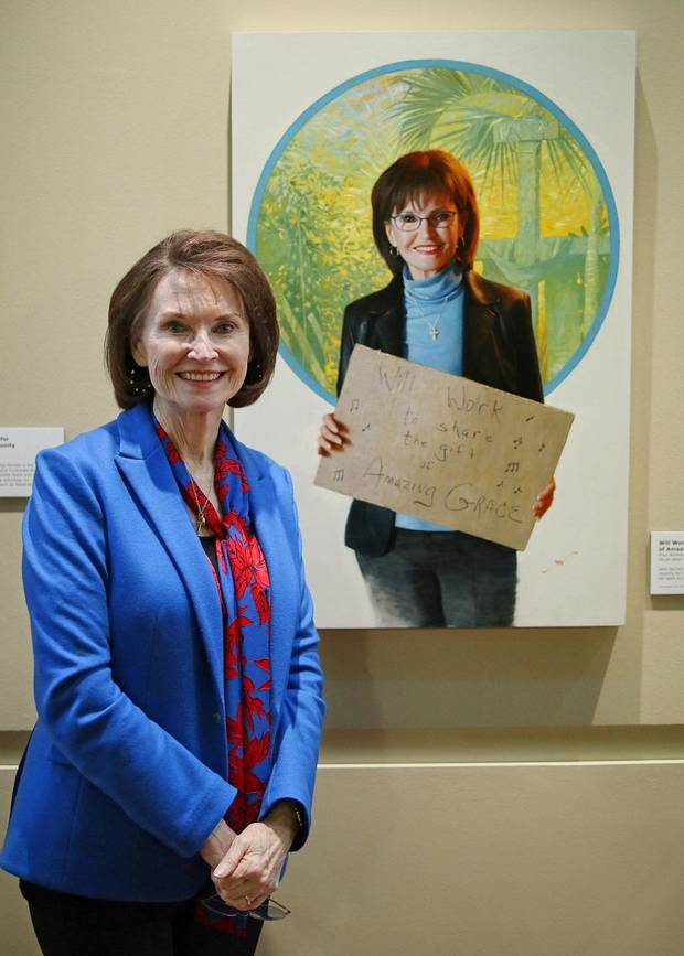 "Jane Jayroe Gamble stands in front of her portrait by Georgia-based Oklahoma native Mike Wimmer at the Oklahoma History Center, Thursday, March 21, 2019. An exhibit of Wimmer's portraits of Oklahomans titled ""Will Work For ..."" is on view through June 29 at the history Center. [Photo by Doug Hoke/The Oklahoman]"