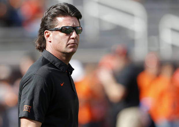 1300db51af1d Oklahoma State head coach Mike Gundy watches warm ups before the Bedlam  college football game between