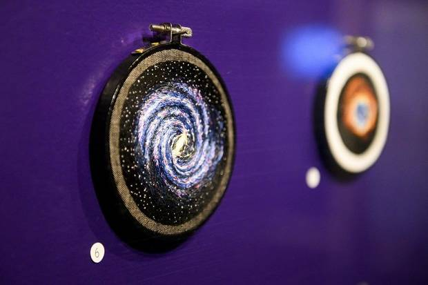 "Norman fiber artist Darci Lenker created a series of tiny embroidered circles depicting nebulae and galaxies for the exhibit ""Cosmic Culture: Intersections of Art and Outer Space,"" on view through March 29 at Science Museum Oklahoma. [Photo provided]"