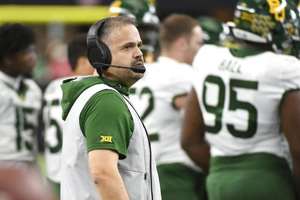 Baylor head coach Matt Rhule watches from the sidelines during a timeout in the first half of an NCAA college football game against Oklahoma for the Big 12 Conference championship, Saturday, Dec. 7, 2019, in Arlington, Texas. (AP Photo/Jeffrey McWhorter)