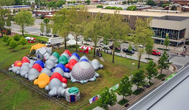 "Crews put the finishing touches on setup as John Rex students get a sneak peak of the Architects of Air inflatable art exhibit called ""Luminarium Albesila,"" featured in the RexFest fundraiser at Together Square in Oklahoma City. [Photo by Chris Landsberger, The Oklahoman]"