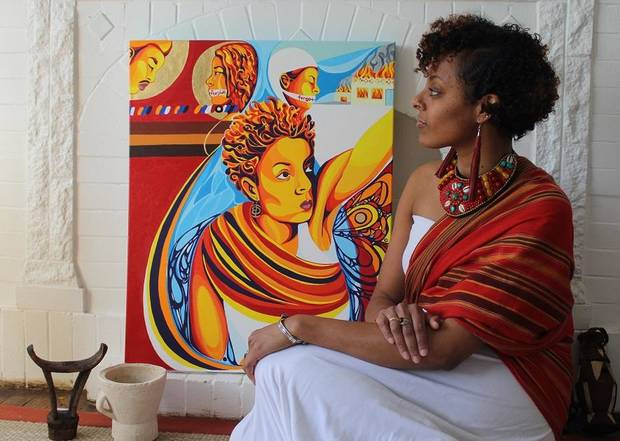 "Oklahoma City artist Ebony Iman Dallas is showing a series of personal paintings with her new solo exhibit ""Through Abahay's Eyes (Through My Father's Eyes),"" opening April 6 at The Paseo Plunge. Shown with the artist is her self-portrait titled ""The Flood Will No Longer Suppress Me."" [Photo provided]"