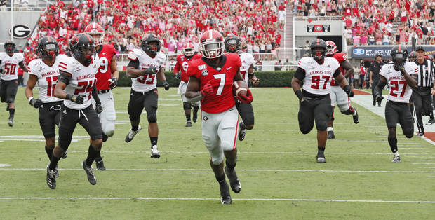 Georgia tailback D'Andre Swift scores a touchdown against Arkansas State at Sanford Stadium last Saturday. (Atlanta Journal-Constitution)