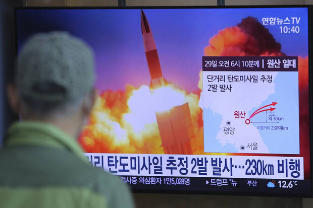 North Korea test fires missiles amid worries about outbreak