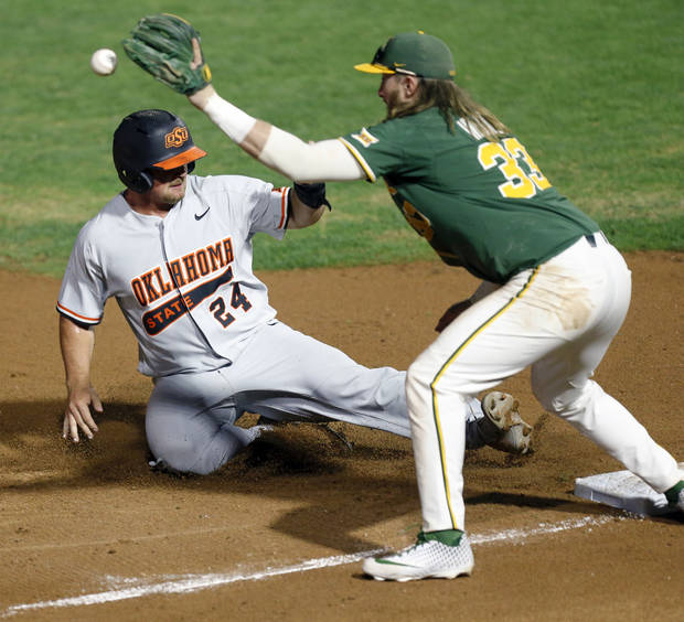 OSU's Colin Simpson slides safely into third base as Baylor's Davis Wendzel catches the ball in the fourth inning  Thursday night. (Photo by Nate Billings)