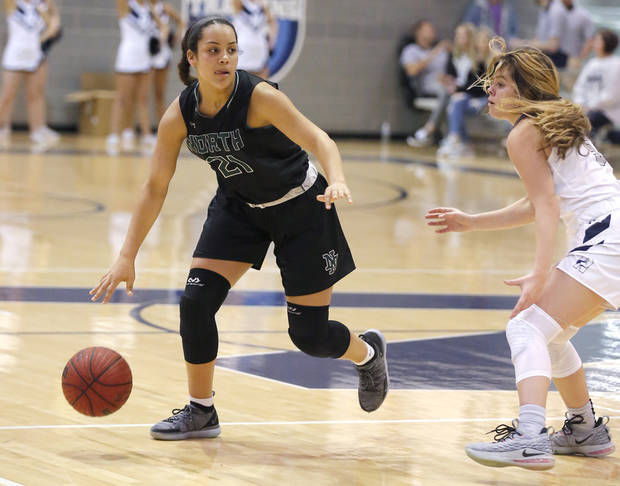 Norman North's Jacie Evans looks to get by Edmond North's Amaia Maxwell during the girls high school basketball game between Edmond North and Norman North at Edmond North High School in Edmond, Okla., Friday, Jan. 4, 2019. Photo by Sarah Phipps, The Oklahoman