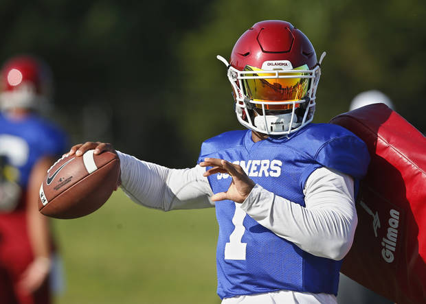 FILE - In this Monday, Aug. 6, 2018, file photo, Oklahoma quarterback Kyler Murray (1) throws during an NCAA college football practice in Norman, Okla. Murray has been picked as Oklahoma's starting quarterback. (AP Photo/Sue Ogrocki, File)