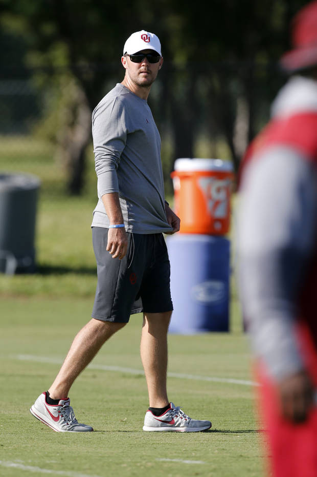 Lincoln Riley watches practice Monday. (Photo by Steve Sisney)