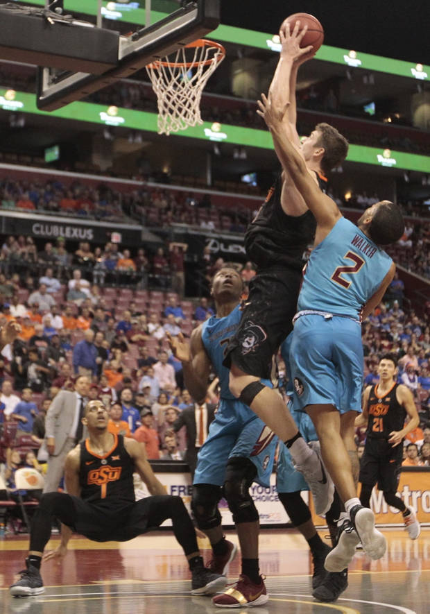 Oklahoma State shocks No. 19 Florida State 71-70 on late tip-in