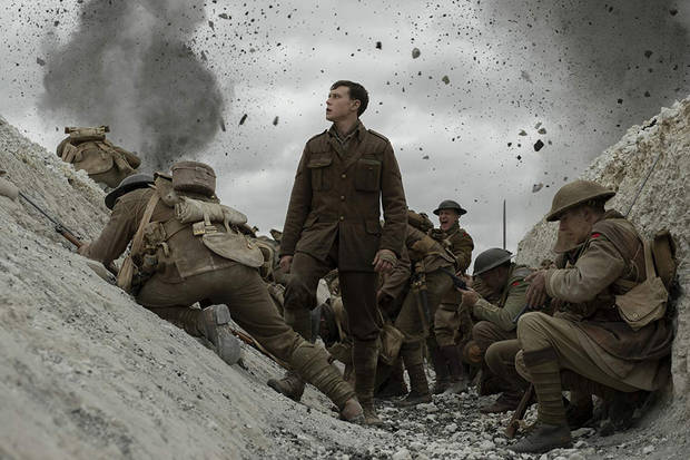 "George MacKay, center, stars in ""1917."" [Universal Pictures photo]"