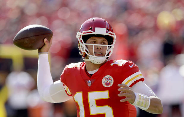 Kansas City Chiefs quarterback Patrick Mahomes looks to throw a pass during  the first half of 4c68b5a75