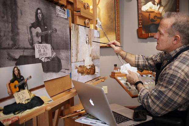 "Mike Wimmer works on a painting in his ""Will Work For ..."" portrait series during his residency at the Skirvin Hilton Hotel Thursday, December 29, 2016. [Doug Hoke/The Oklahoman Archives]"