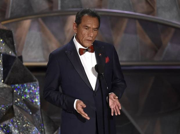 Wes Studi introduces a tribute to films that honor service in the military at the Oscars on Sunday, March 4, 2018, at the Dolby Theatre in Los Angeles. [Photo by Chris Pizzello/Invision/AP]