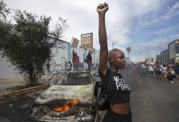 Protests over police killings rage in dozens of US cities