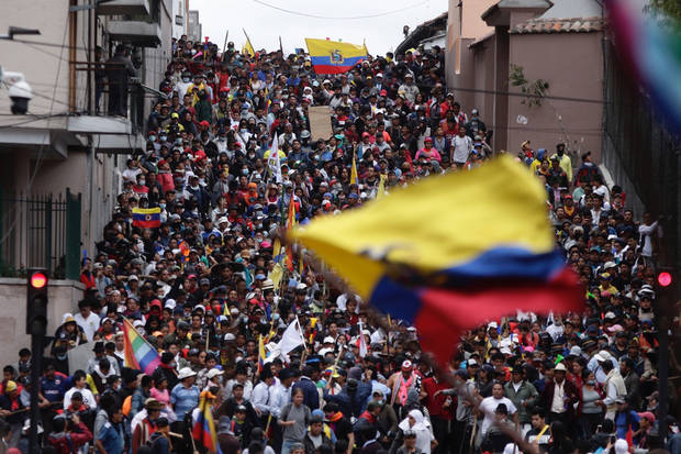 Ecuador's protesters march; some clashes break out in Quito