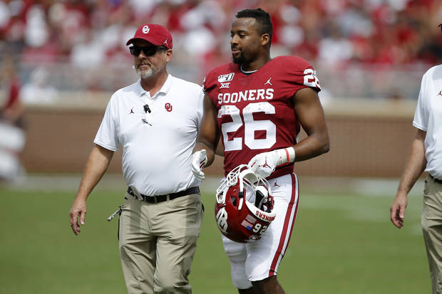 OU tailback Kennedy Brooks walks off the field after he was injured against Texas Tech. (Photo by Bryan Terry)