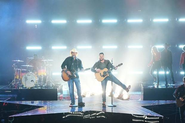 "Toby Keith, left, Dexter Roberts perform Tuesday on ""The Voice"" Season 16 finale. [Photo by Tyler Golden/NBC]"