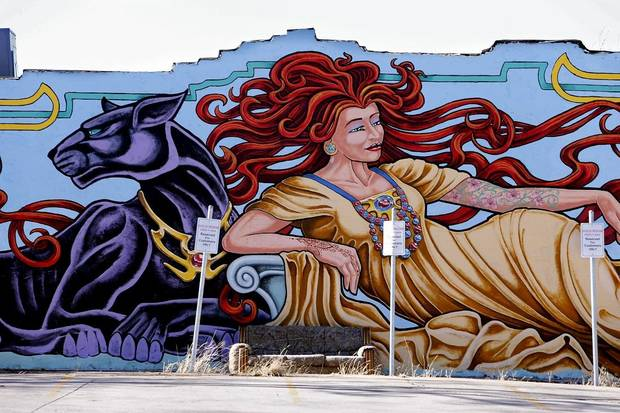 "The mural ""Tattoo Woman"" by Derek Vosten is seen on Porter Ave. on Saturday, Nov. 29, 2014 in Norman, Okla. [The Oklahoman Archives]"