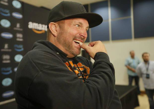 Garth Brooks speaks to the media during a press conference at the Chesapeake Energy Arena in Oklahoma City, Friday, July 14, 2017. [Sarah Phipps/The Oklahoman Archives]