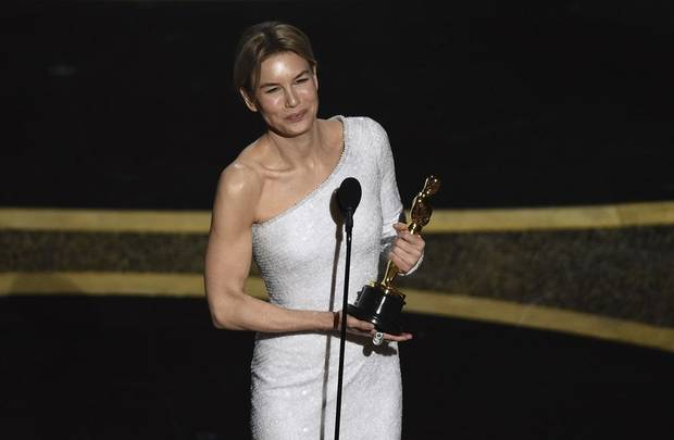 "Renee Zellweger accepts the award for best performance by an actress in a leading role for ""Judy"" at the Oscars on Sunday, Feb. 9, 2020, at the Dolby Theatre in Los Angeles. [AP Photo/Chris Pizzello]"