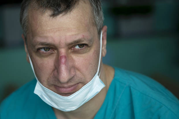 After weeks of COVID-19 cases, Russian doctor craves quiet