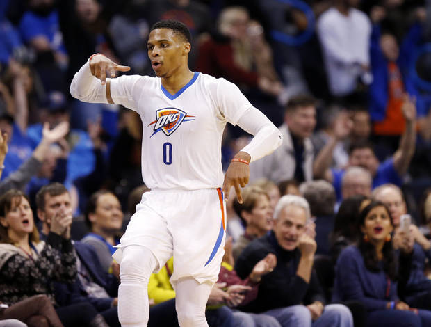 Oklahoma City's Russell Westbrook (0) celebrates a 3-point basket late in the fourth quarter during an NBA basketball game between the Dallas Mavericks and the Oklahoma City Thunder at Chesapeake Energy Arena in Oklahoma City, Thursday, Jan. 26, 2017. Oklahoma City won 109-98. Photo by Nate Billings, The Oklahoman