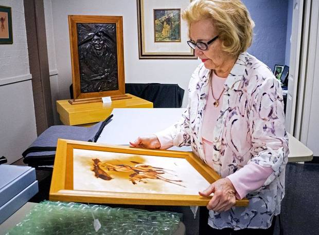 Lou Kerr works to pack artwork at the Red Earth Art Center in Oklahoma City, Okla. on Thursday, May 16, 2019. The center is relocating to ground floor of BancFirst Tower. [Chris Landsberger/The Oklahoman]