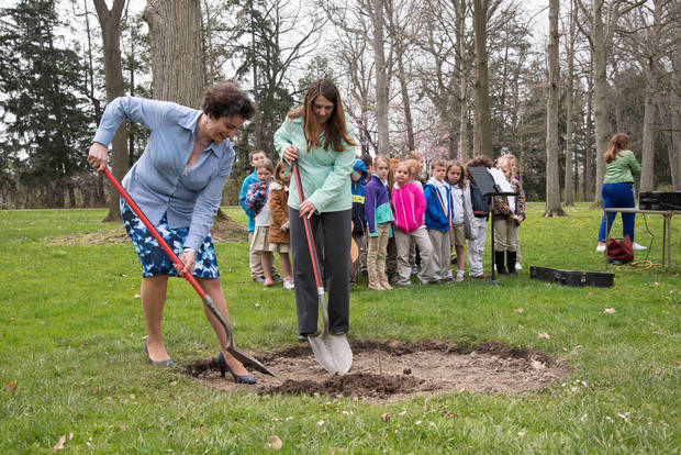 Christie Weininger, executive director of the Hayes Presidential Library & Museums, (left), and Jamie Gotten of the Fremont Tree and Beautification Commission, dig a hole for the tree. Photo by Gil Gonzalez/Hayes Presidential Library & Museums