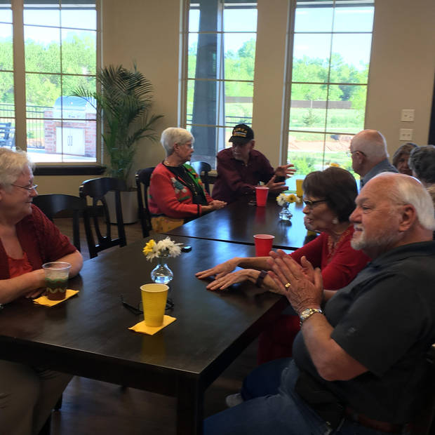 Whispering Creek residents visiting at their club house. Photo provided.