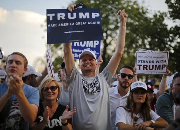 Justin Maddix of Elk City, center, holds a sign for Donald Trump during the Republican presidential candidate's rally at the Oklahoma State Fair in Oklahoma City, Friday, September 25, 2015. Photo by Bryan Terry, The Oklahoman