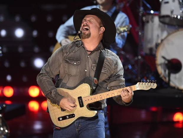 Artist of the decade award winner Garth Brooks performs at the iHeartRadio Music Awards on Thursday, March 14, 2019, at the Microsoft Theater in Los Angeles. [Photo by Chris Pizzello/Invision/AP]