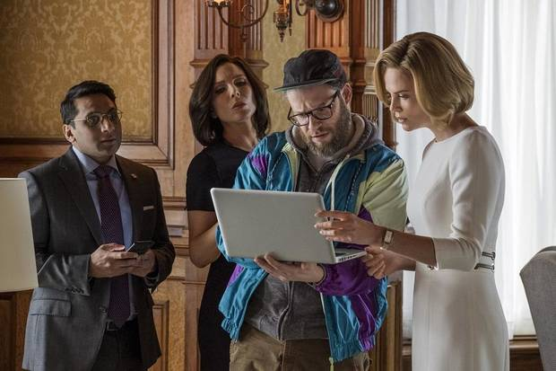 "Ravi Patel, from left, June Diane Raphael, Seth Rogen and Charlize Theron appear in a scene from ""Long Shot."" [Lionsgate photo]"