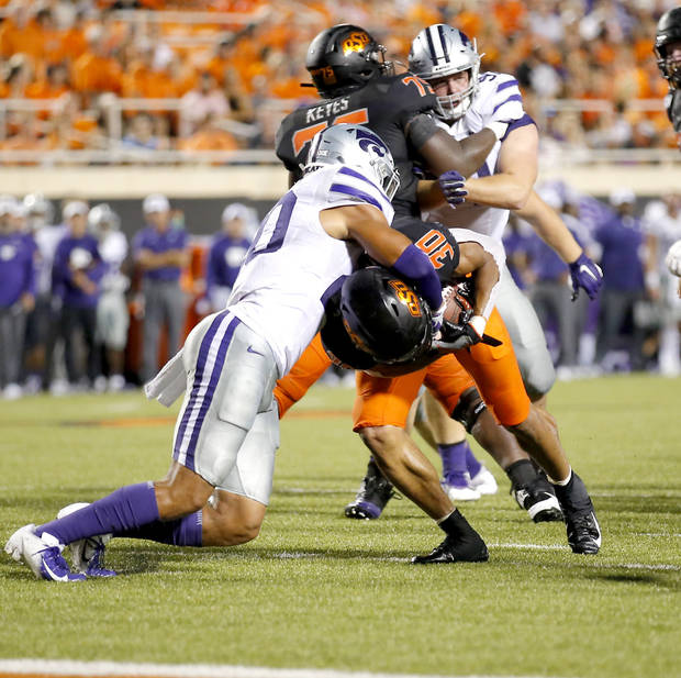 OSU tailback Chuba Hubbard fights Kansas State's Denzel Goolsby (20) to the goal line in the fourth quarter Saturday. (Photo by Sarah Phipps)