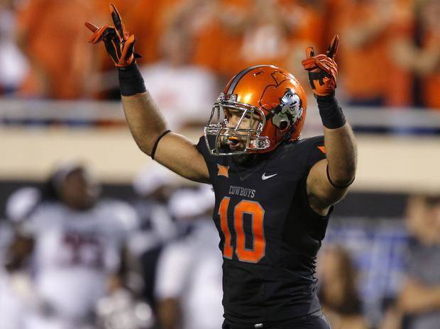 Oklahoma State's Seth Jacobs (10) celebrates after an interception during a college football game between the Oklahoma State Cowboys (OSU) and the Texas Tech Red Raiders at Boone Pickens Stadium in Stillwater, Okla., Thursday, Sept. 25, 2014. Photo by Bryan Terry, The Oklahoman