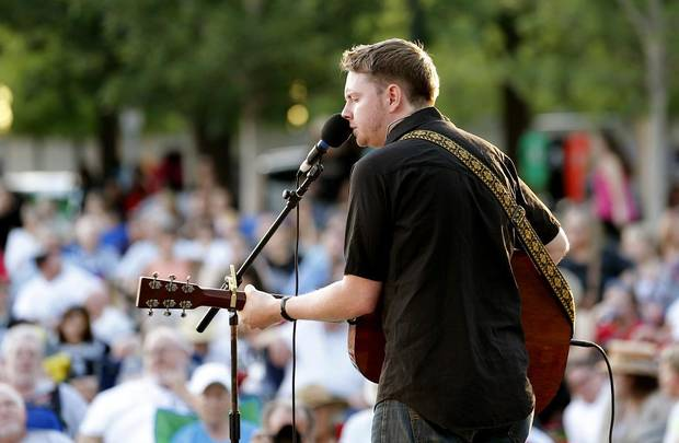 Grammy-nominated Oklahoma singer-songwriter John Fullbright performs a free concert at the Myriad Botanical Gardens in Oklahoma City, Friday, August 1, 2014. [Bryan Terry/The Oklahoman Archives]