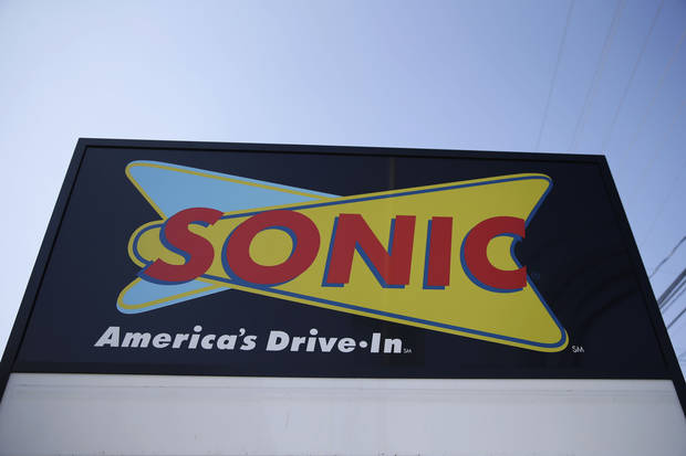FILE- This March 9, 2015, file photo shows a sign for a Sonic Drive-In in Holmes, Pa. Arby's owner Inspire Brands is buying the Sonic drive-in hamburger chain. Inspire said Tuesday, Sept. 25, 2018, owning multiple chains will help it share resources, including customer loyalty data and suppliers. (AP Photo/Matt Rourke, File)