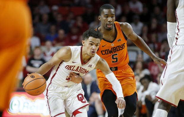 Oklahoma's Trae Young (11) goes past Oklahoma State's Tavarius Shine (5) during a Bedlam basketball game between the Oklahoma Sooners (OU) and the Oklahoma State Cowboys (OSU) at Lloyd Noble Center in Norman, Okla., Wednesday, Jan. 3, 2018. Photo by Bryan Terry, The Oklahoman