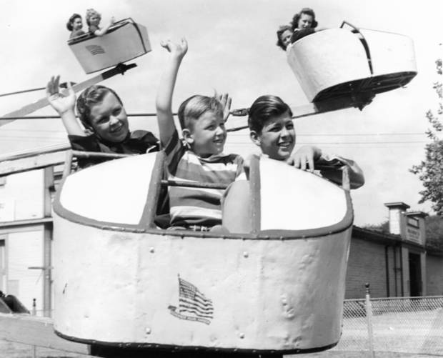 The children of Governor Robert S. Kerr-- Kay Kerr, 12; Bill Kerr, 6 and Breene Kerr, 14--try out the Octopus ride at the state fair. Photo is dated 10/7/1943, but probably taken in September of 1943 during the actual run of the state fair.