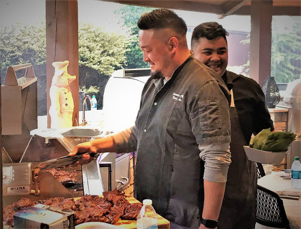 "Chef Kevin Lee, left, is pictured with Danh Do at ""Open Flame."" Lee will appear on ""Guy's Grocery Games"" tonight at 8 p.m."